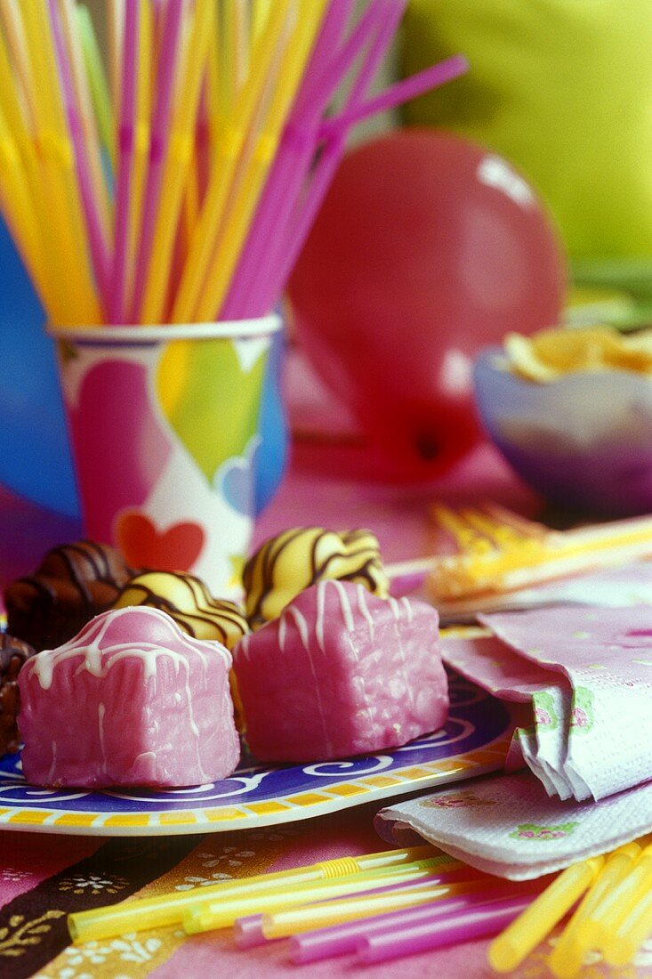 Petit fours on a colourful party table