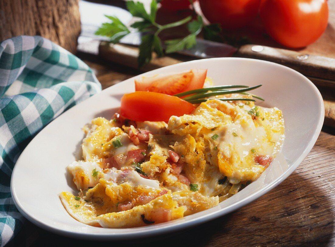 Uova strapazzate allo speck (Scrambled eggs with Tyrolean bacon)
