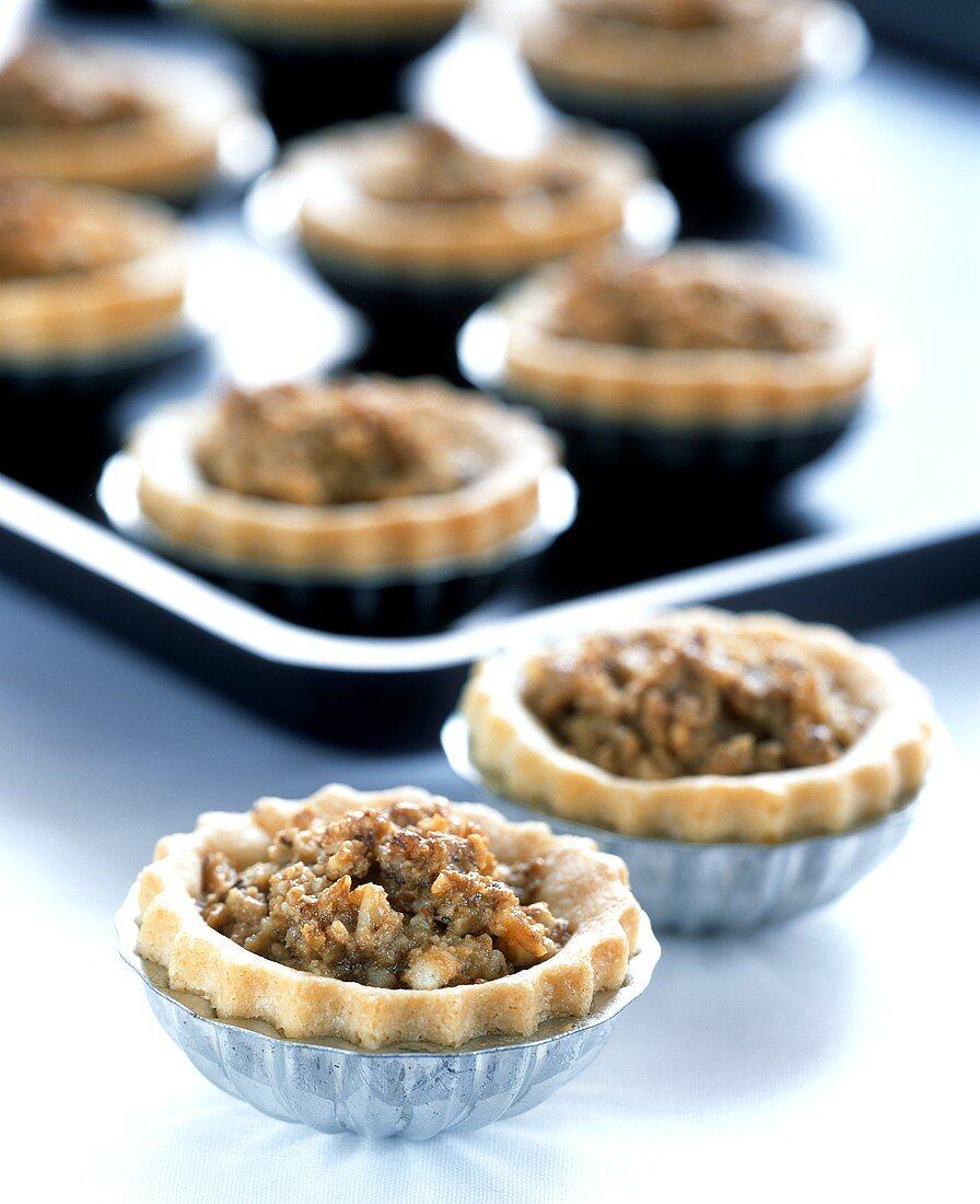 Small nut tartlets in tart tins