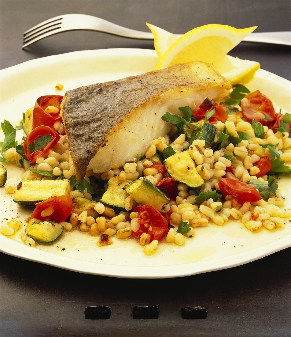 Hake with pearl barley and vegetables