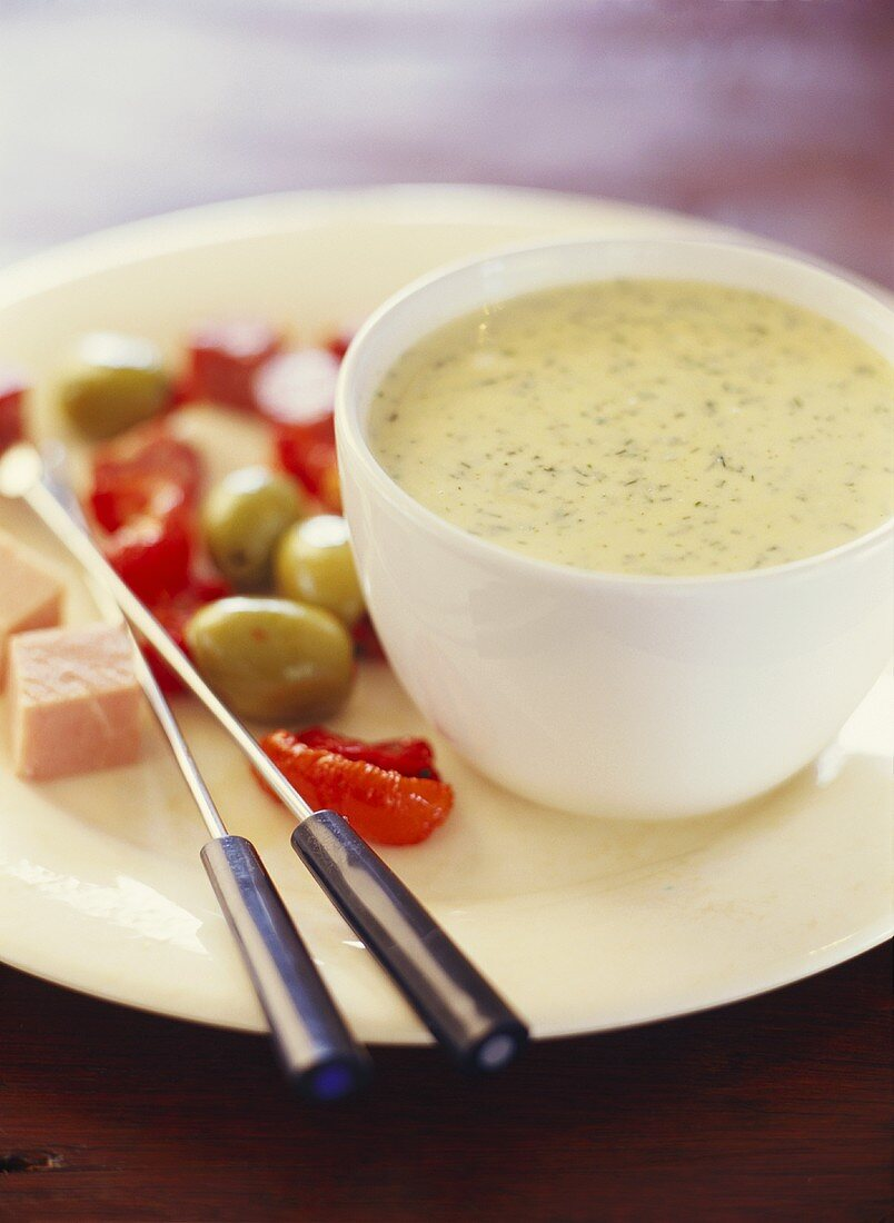 Cheese and herb fondue with vegetables and diced ham