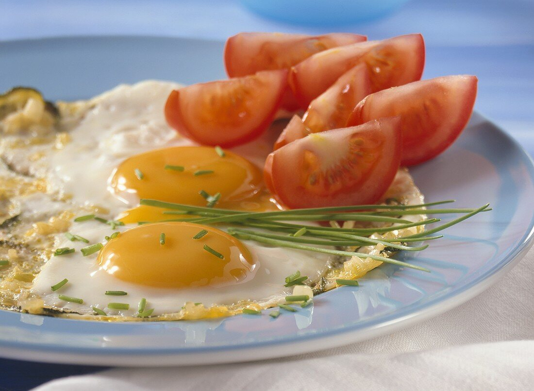Pan-cooked courgettes & eggs & tomato wedge (food combining)