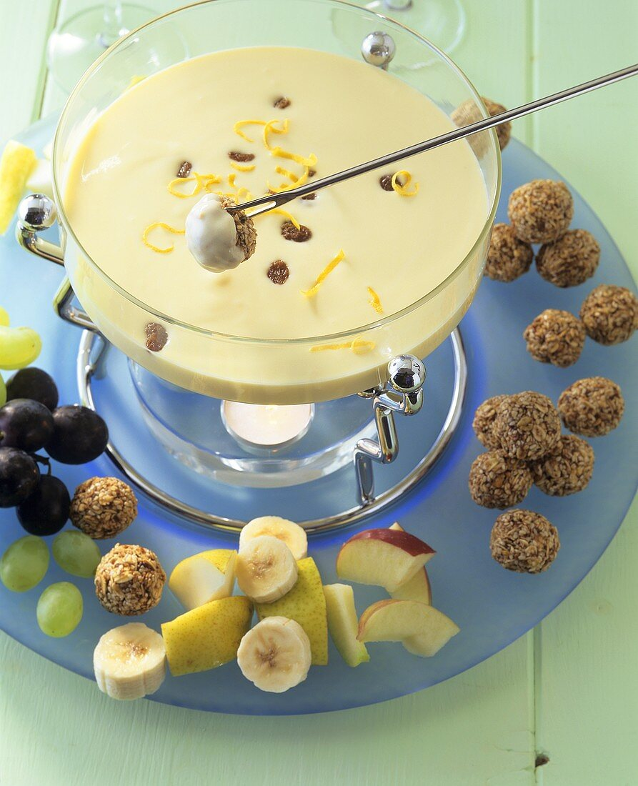 Sweet quark and cream fondue with fruit and muesli balls
