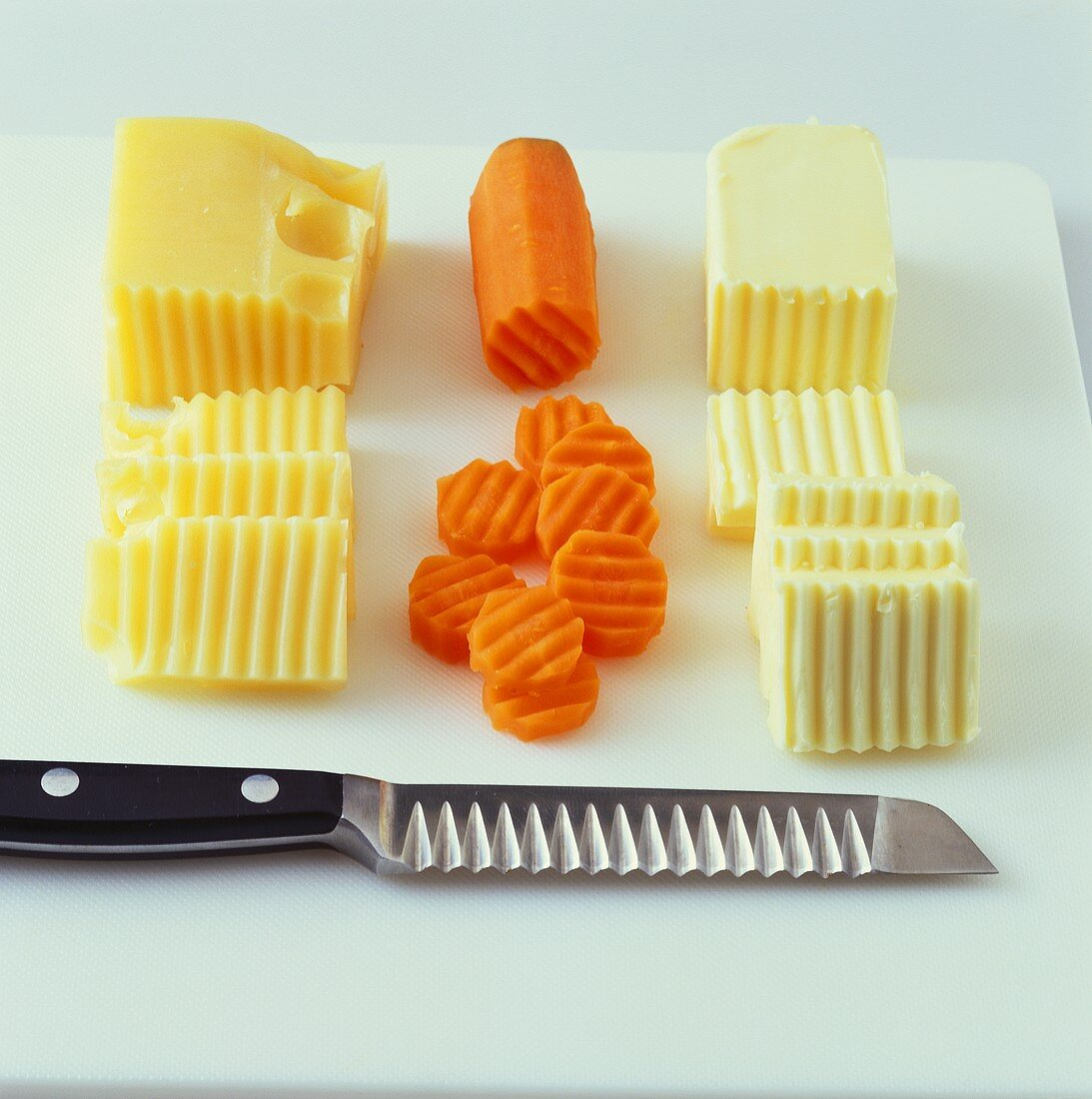 Decorating cheese, vegetables & butter with garnishing knife