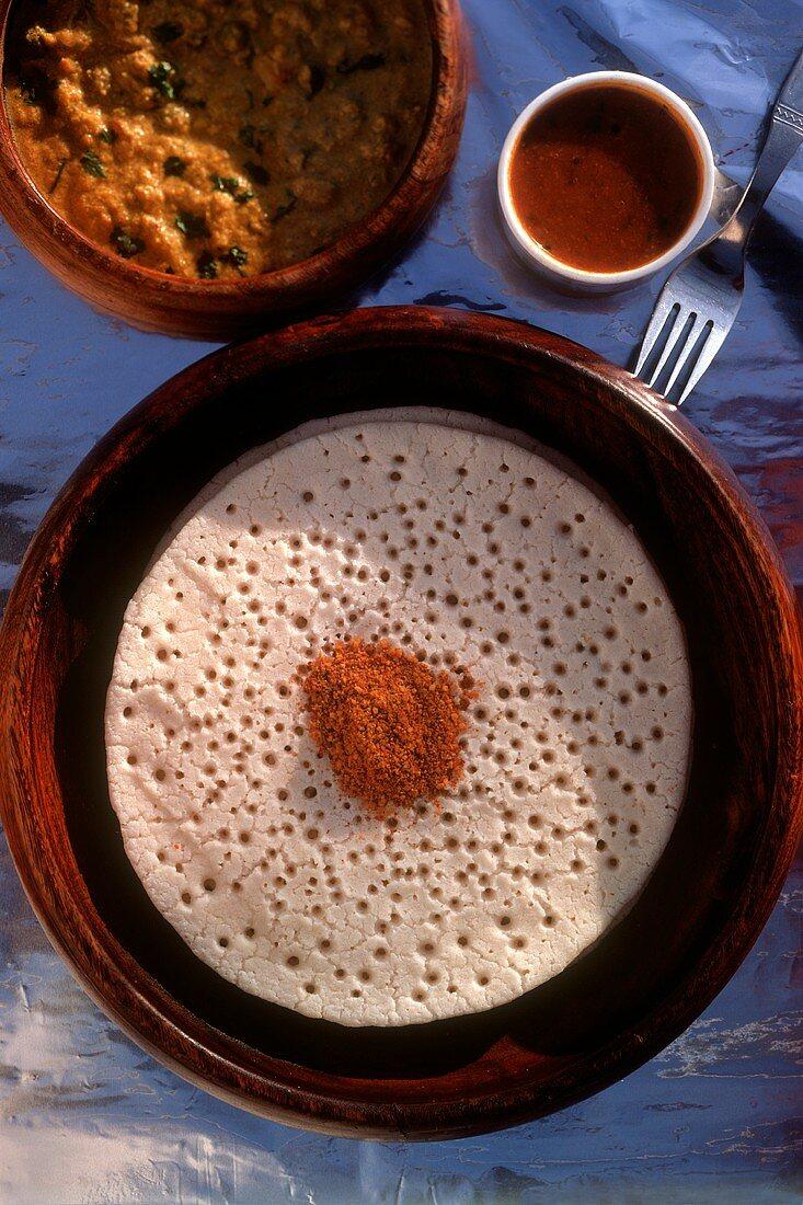 Appam (rice and coconut flake flatbread) Kerala, India