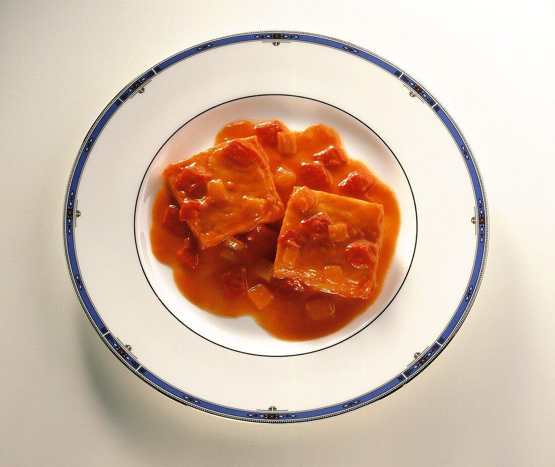 Bacallà amb samfaina (cod with tomato sauce, Spain)