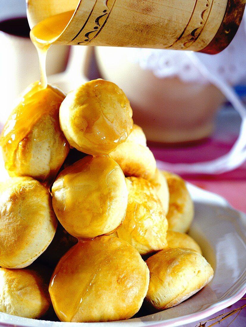 Bomboliki (sweet yeast cakes with honey, Poland)