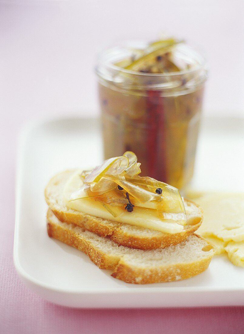 Pickled watermelon rind with Cheddar cheese on white bread