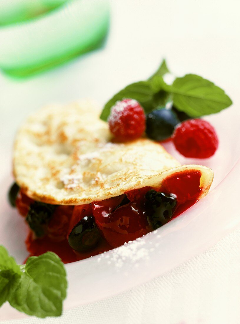 Pancakes filled with red berry compote