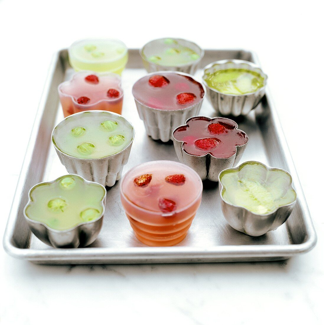 Various fruit jellies in moulds