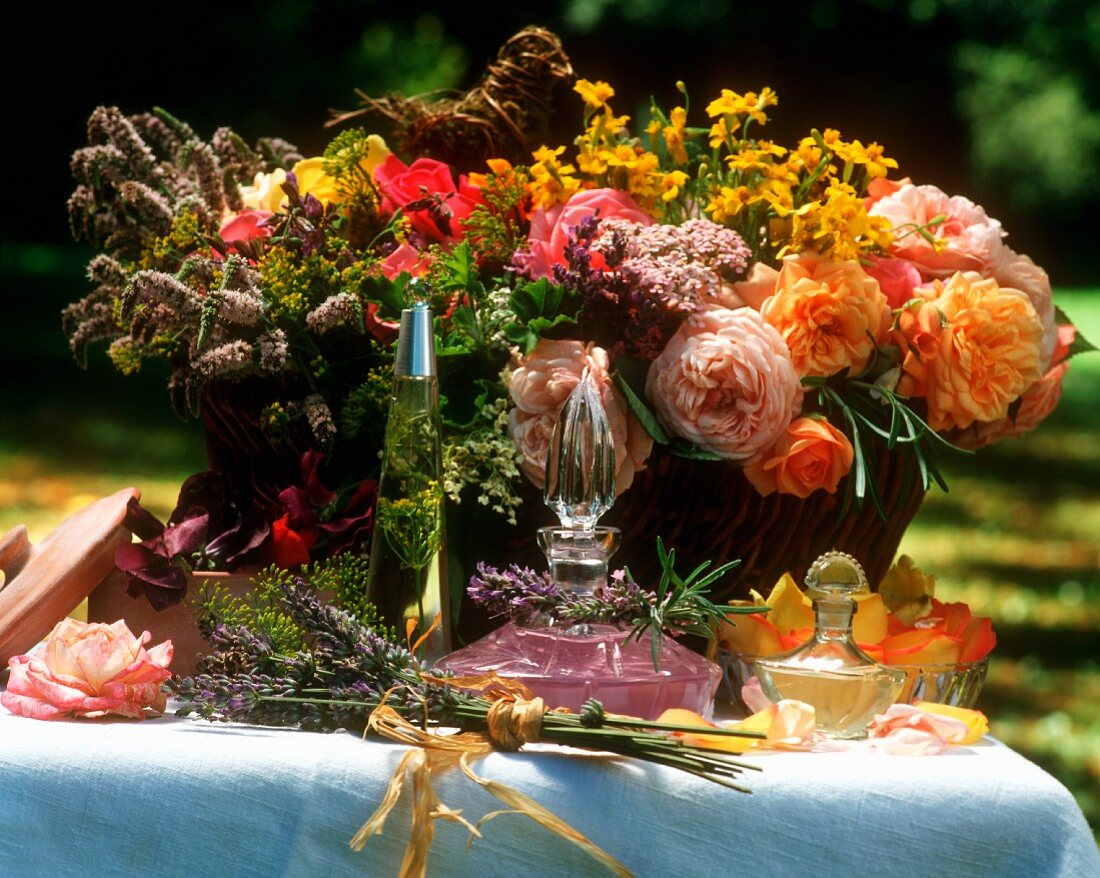 Still life with flowers & eau de toilette on table in open air