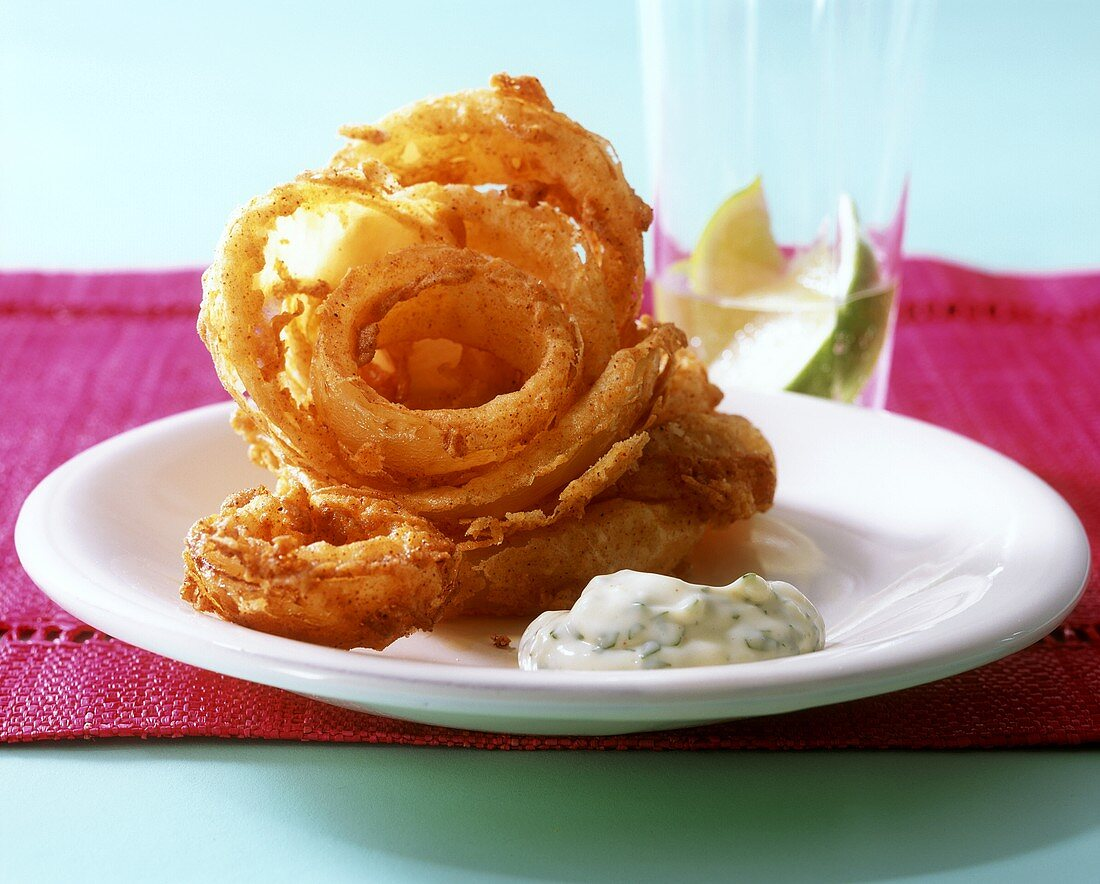 Deep-fried onion rings with herb and garlic mayonnaise