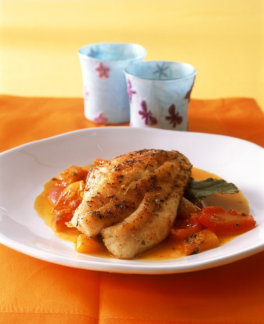Red snapper filet with Adobo seasoning, pepper & tomato ragout