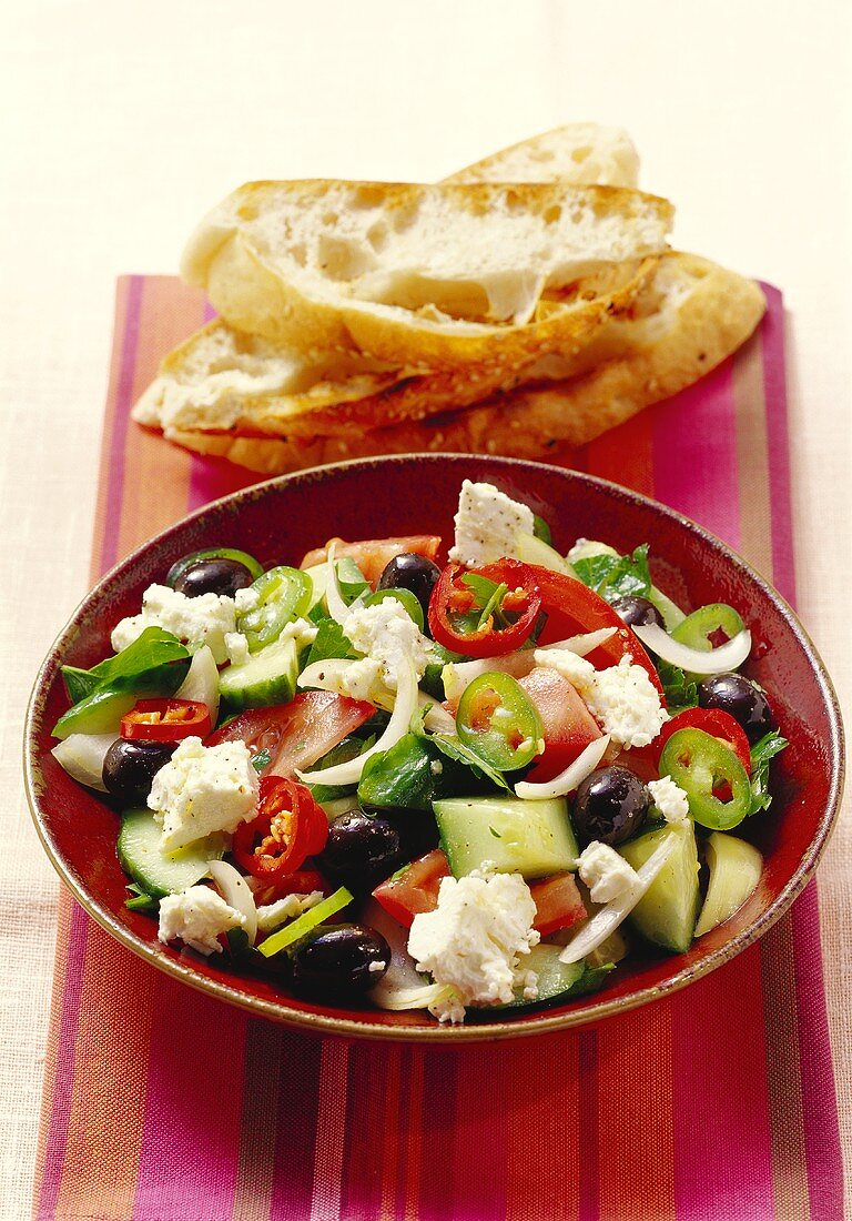 Greek salad with sheep's cheese, with sesame bread