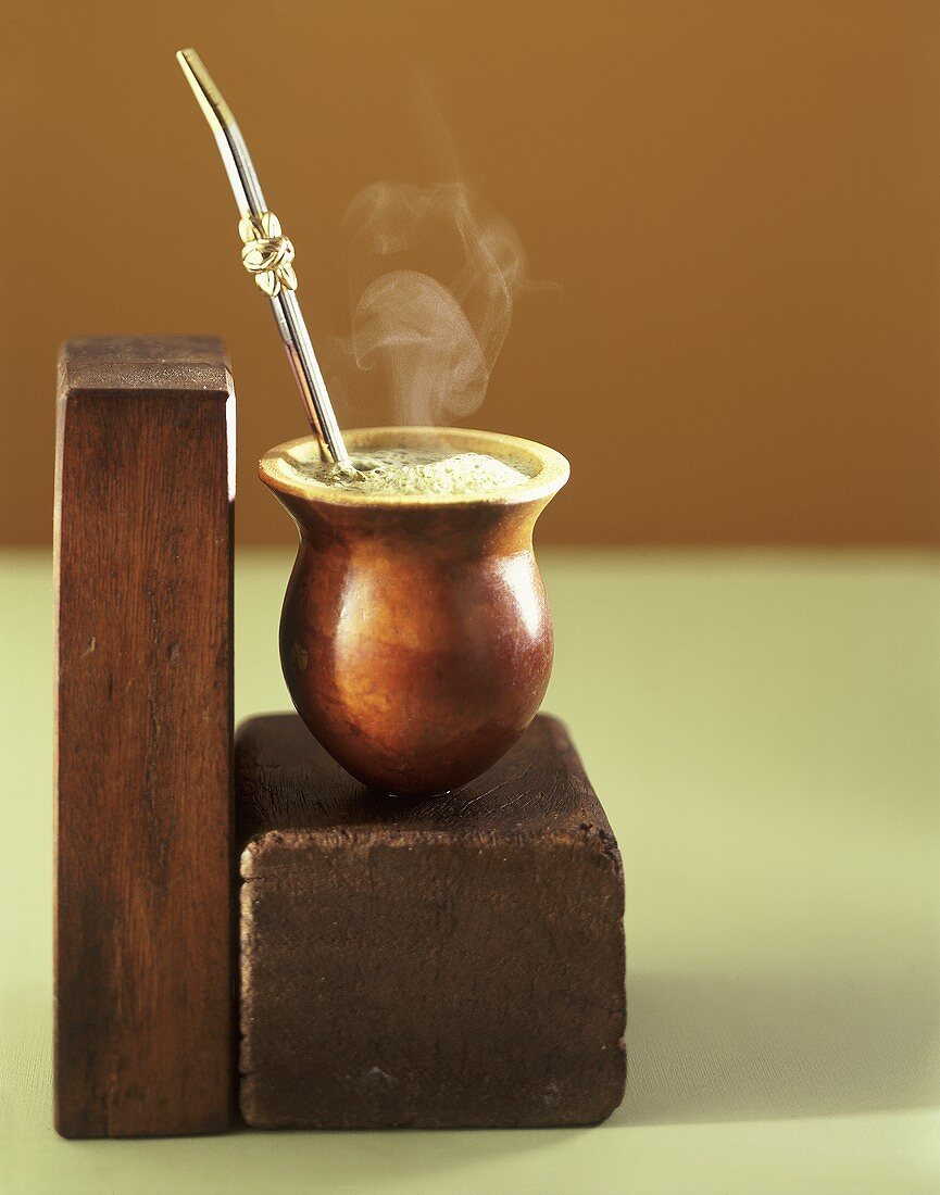 Beaker of Chimarrao with silver straw on wood