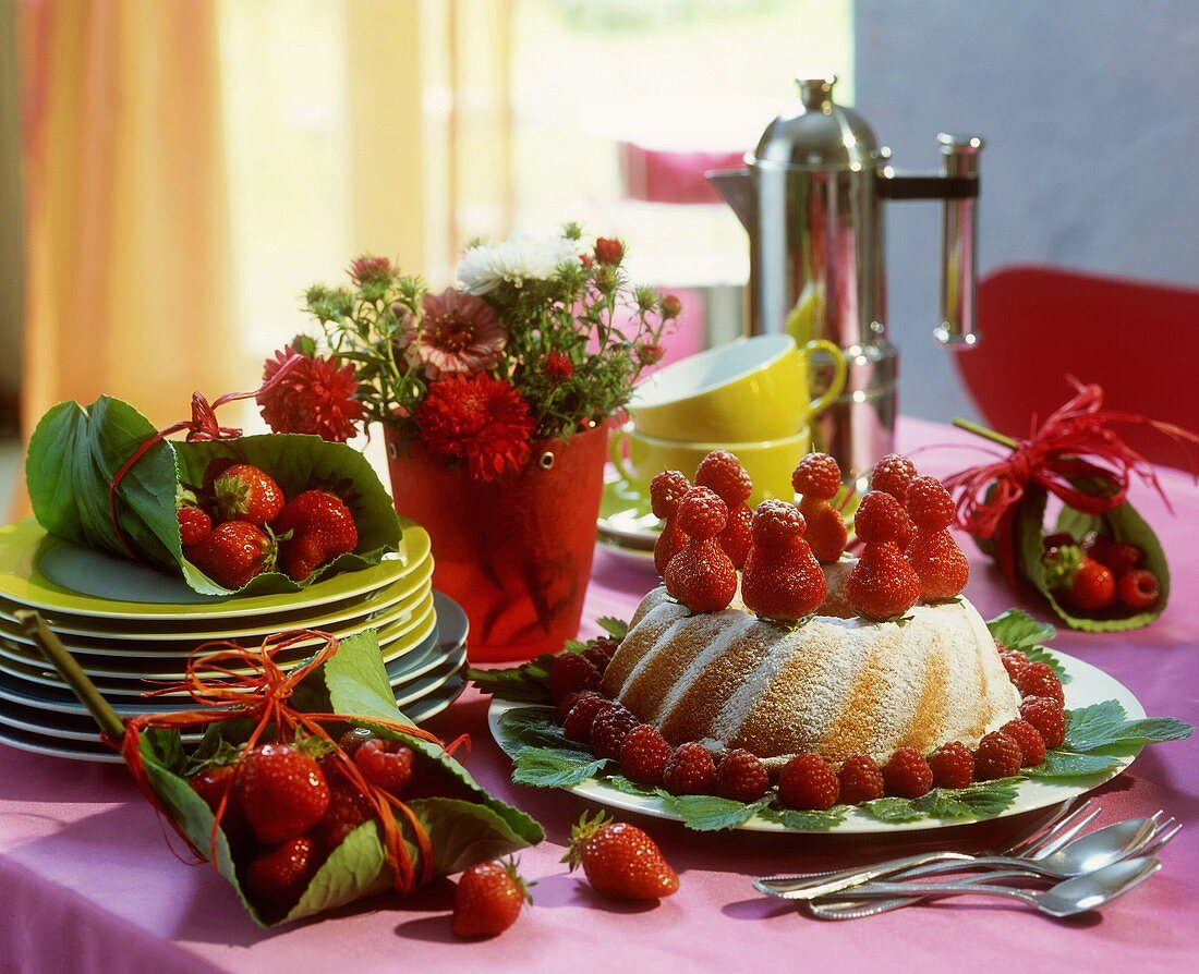 Ring cake with berries & strawberries parcels on coffee table