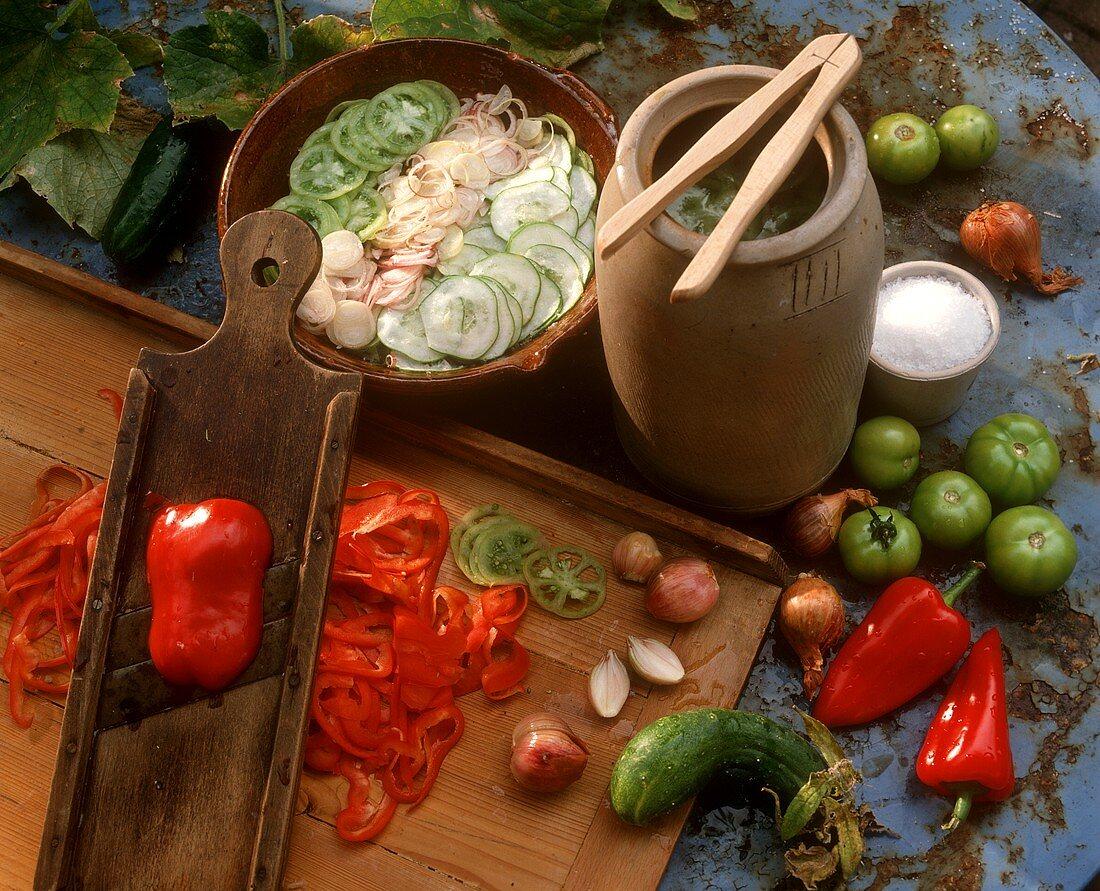Pickling vegetables: vegetables, vegetable slicer, clay jug