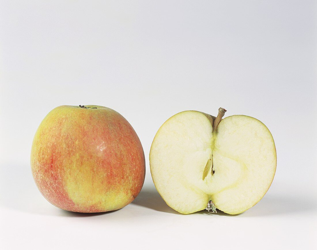 One half and one whole Cox's Orange Pippin apple