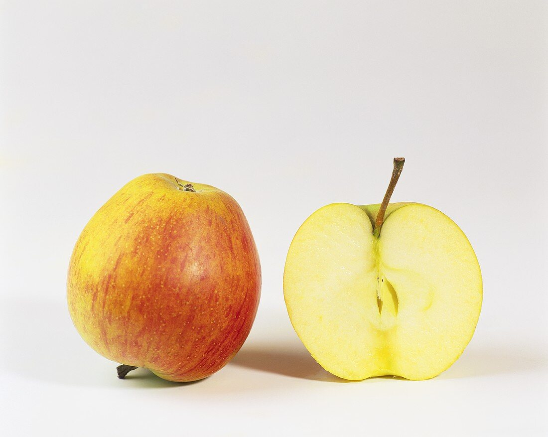 One half and one whole Rubinette apple