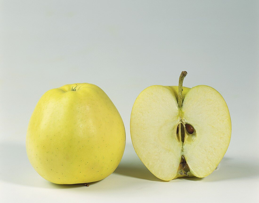 One half and one whole Delicious apple