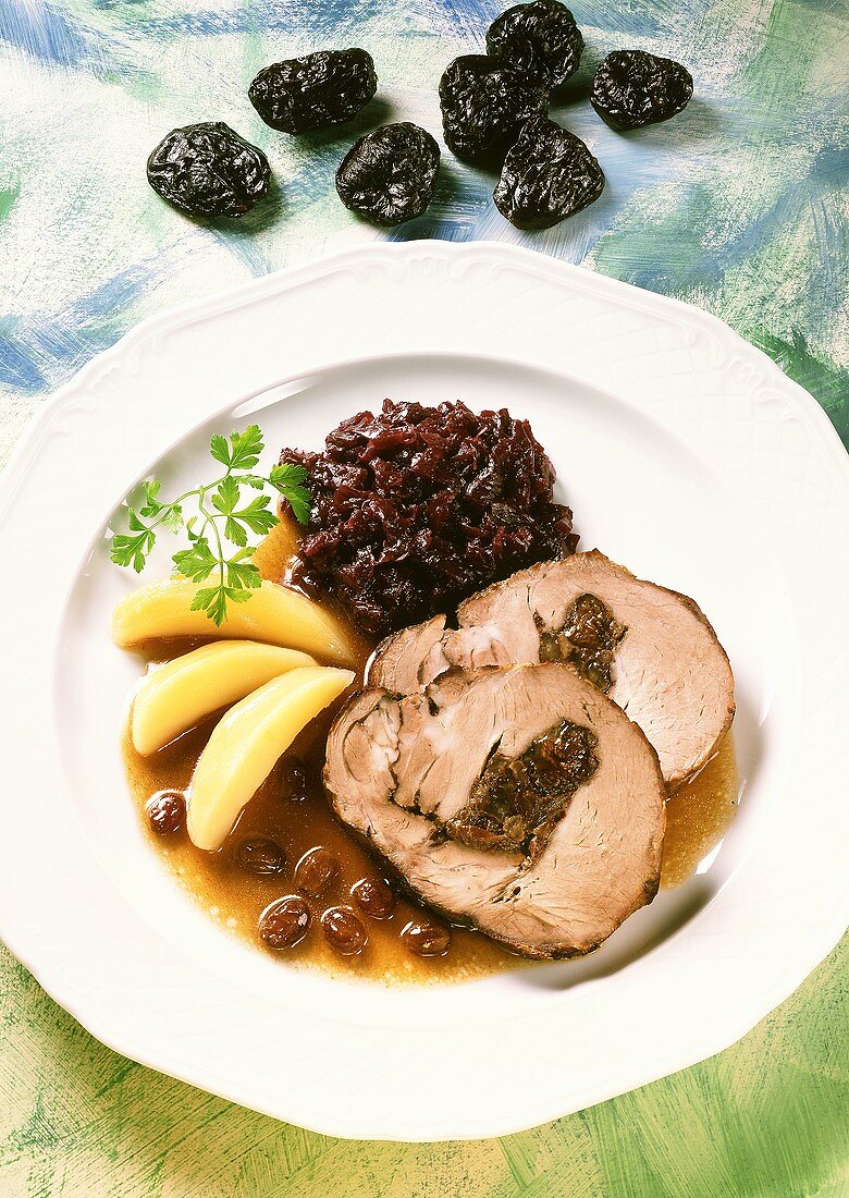Roast pork roll with dried fruit stuffing & red cabbage