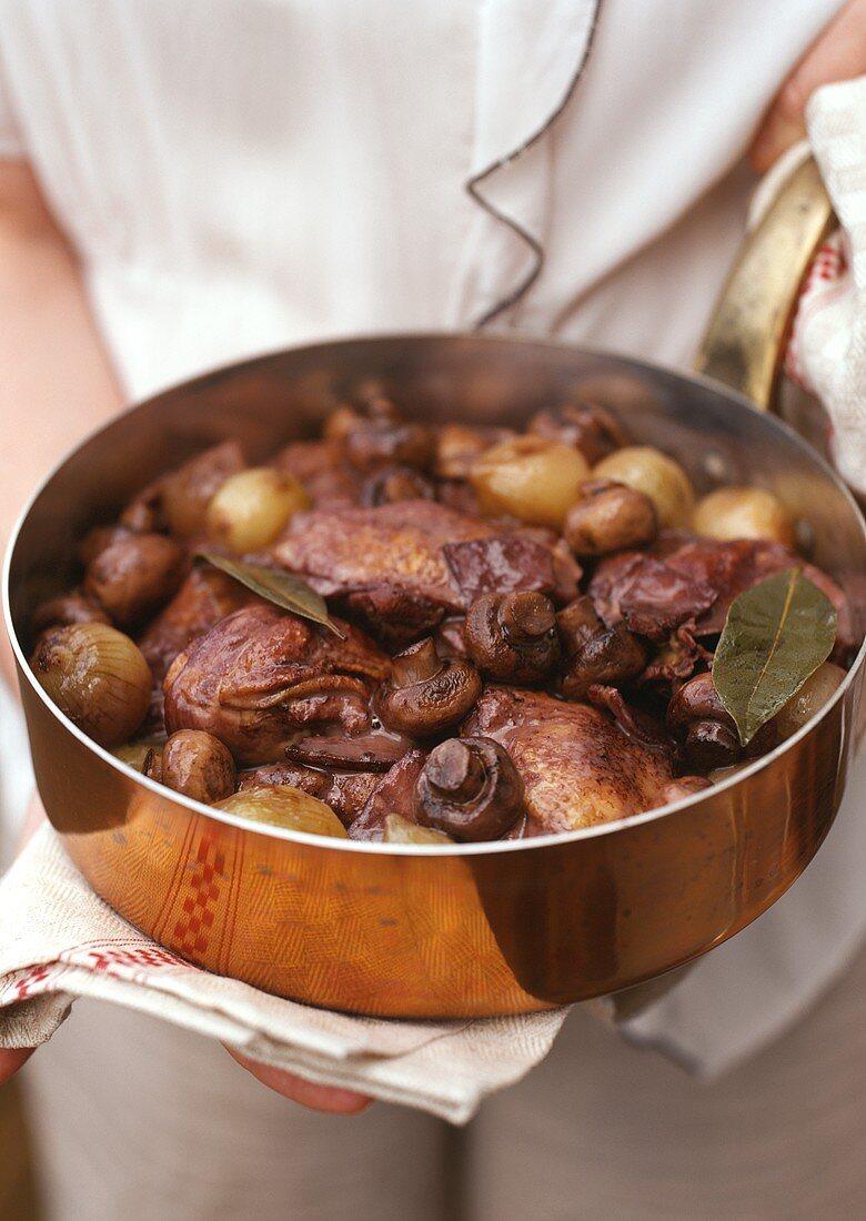 Coq au vin in a copper pan