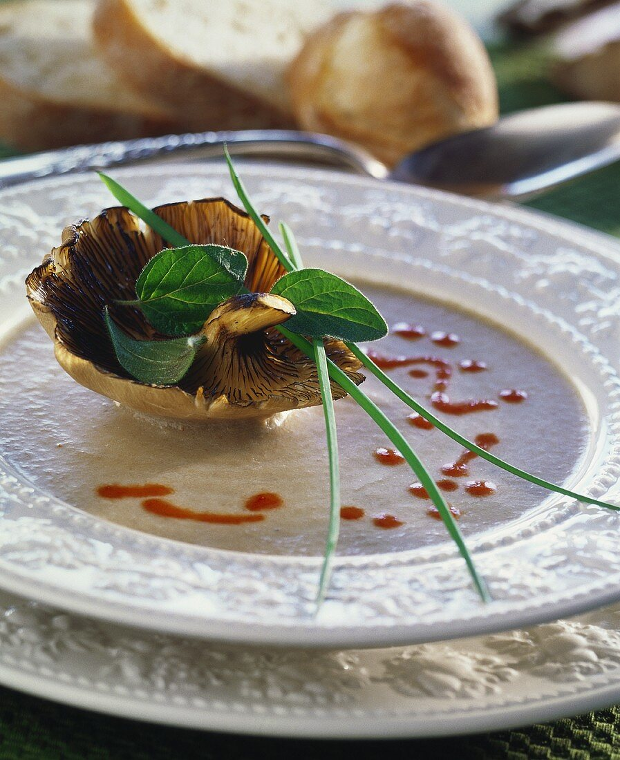 Mushroom soup with mustard, with a grilled oyster mushroom