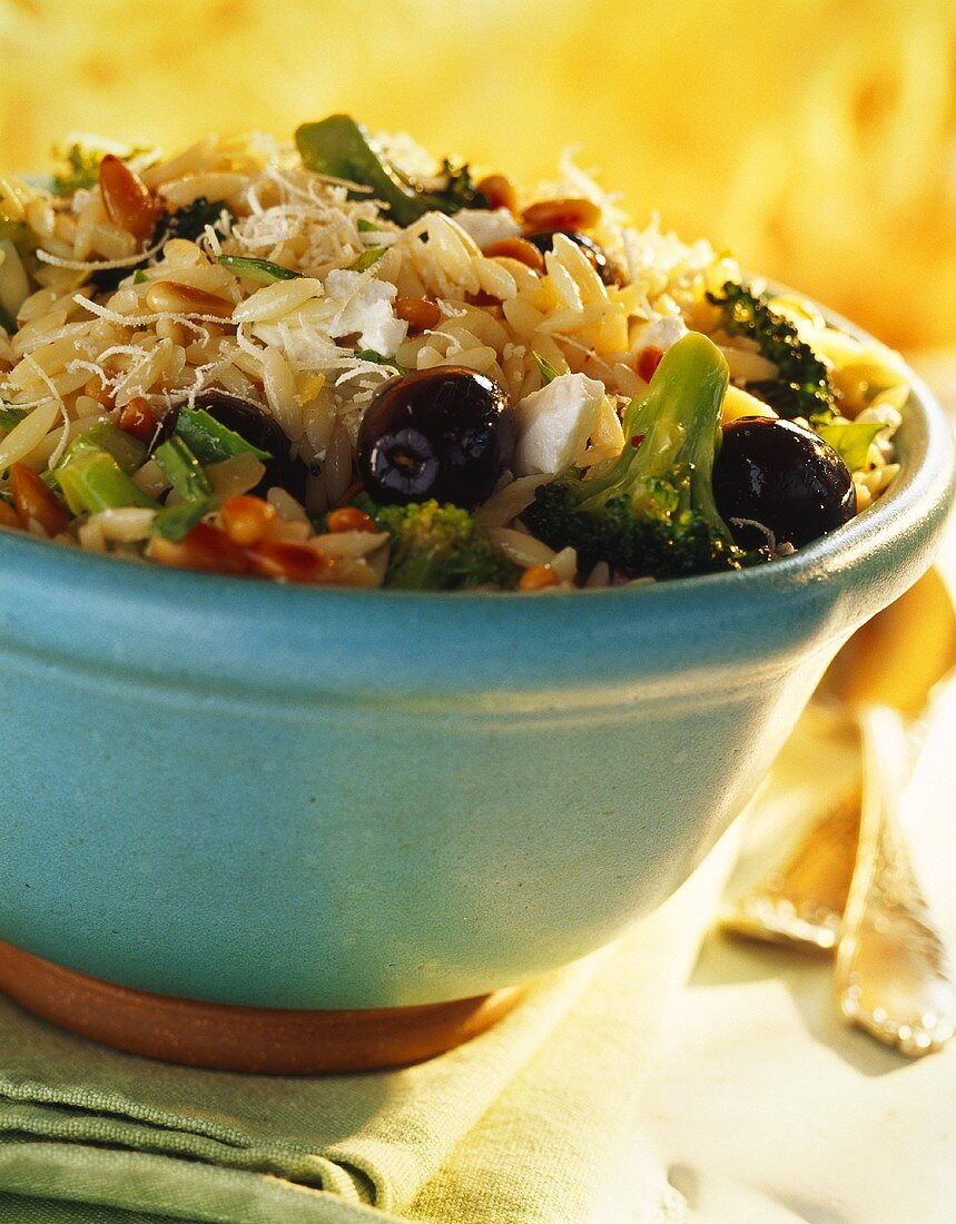 Rice noodle salad with broccoli and black olives