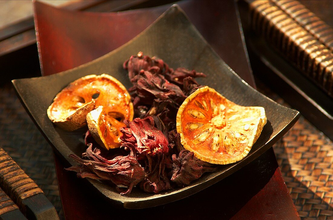 Dried okra flowers and bael fruit in a bowl