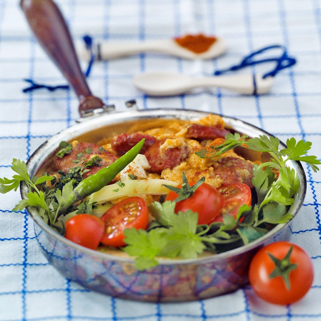 Peasant's omelette with sausage, tomatoes and peppers