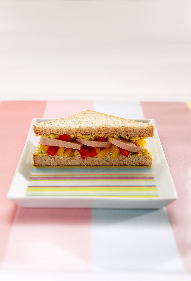 Ring bologna and pieces of pepper in a sandwich