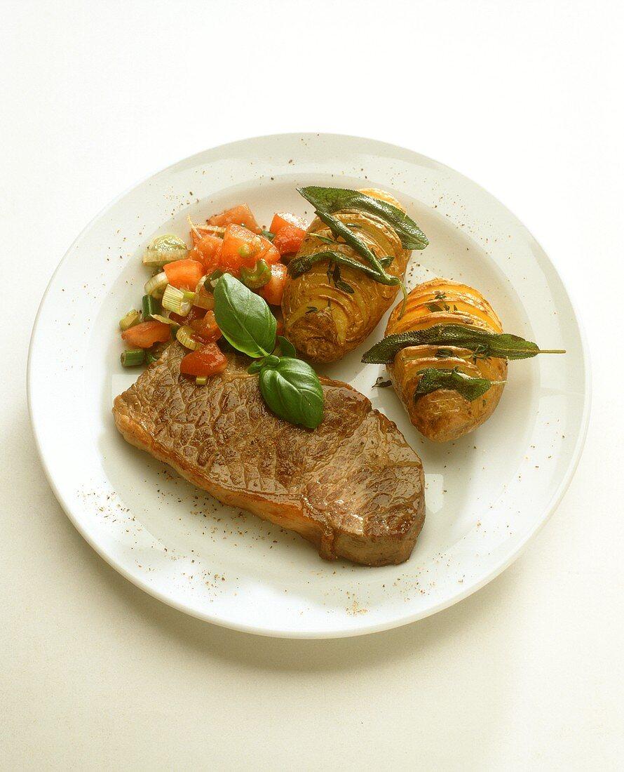 Rump steak with herb potatoes and tomato salsa