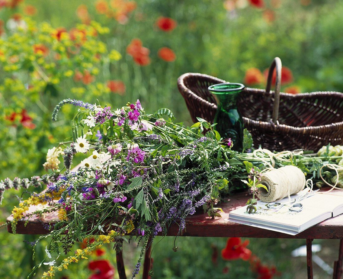 Bunch of wild flowers on garden table