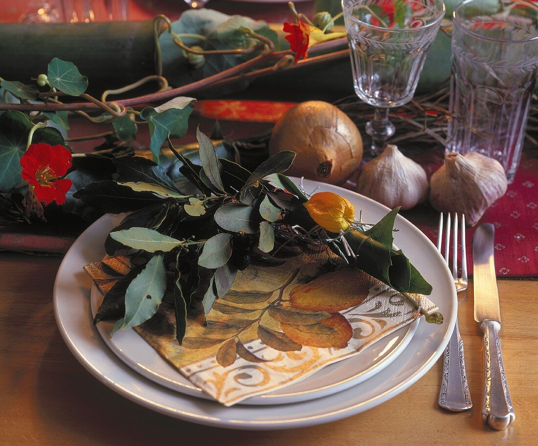 Place-setting decorated with bay leaves and physalis