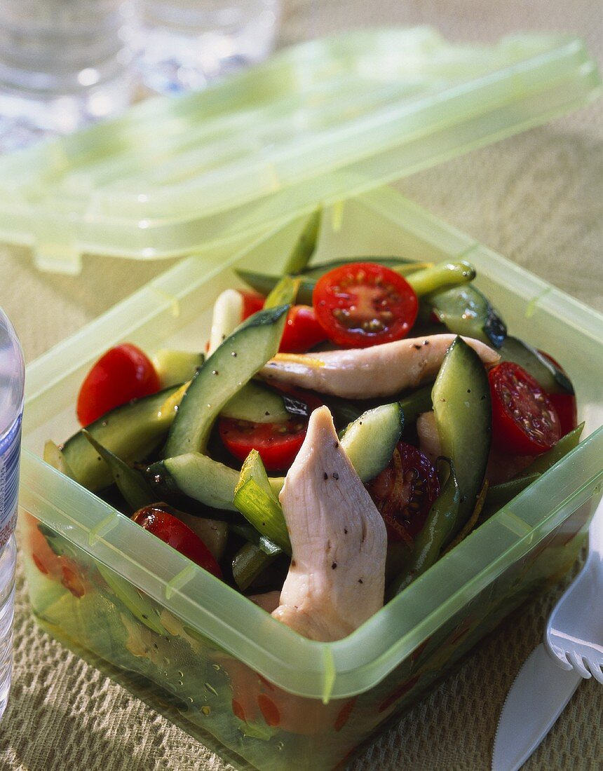 Tomato and cucumber salad with chicken breast