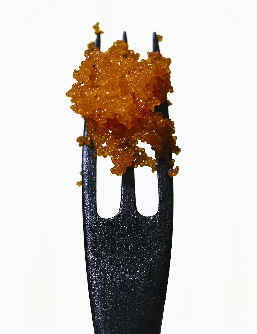 Tobiko (flying fish roe) on a black wooden fork