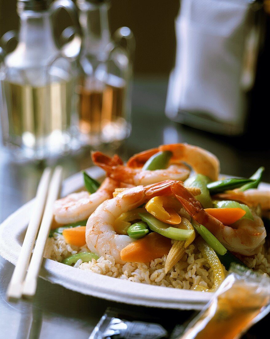 Asian pan-cooked shrimp and vegetable dish on rice