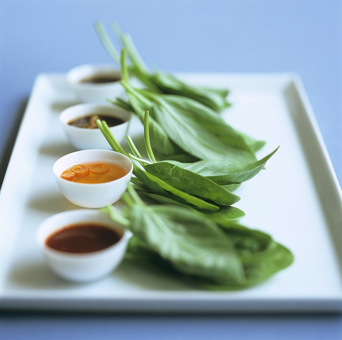 Various Thai sauces and leaves of the Betel plant