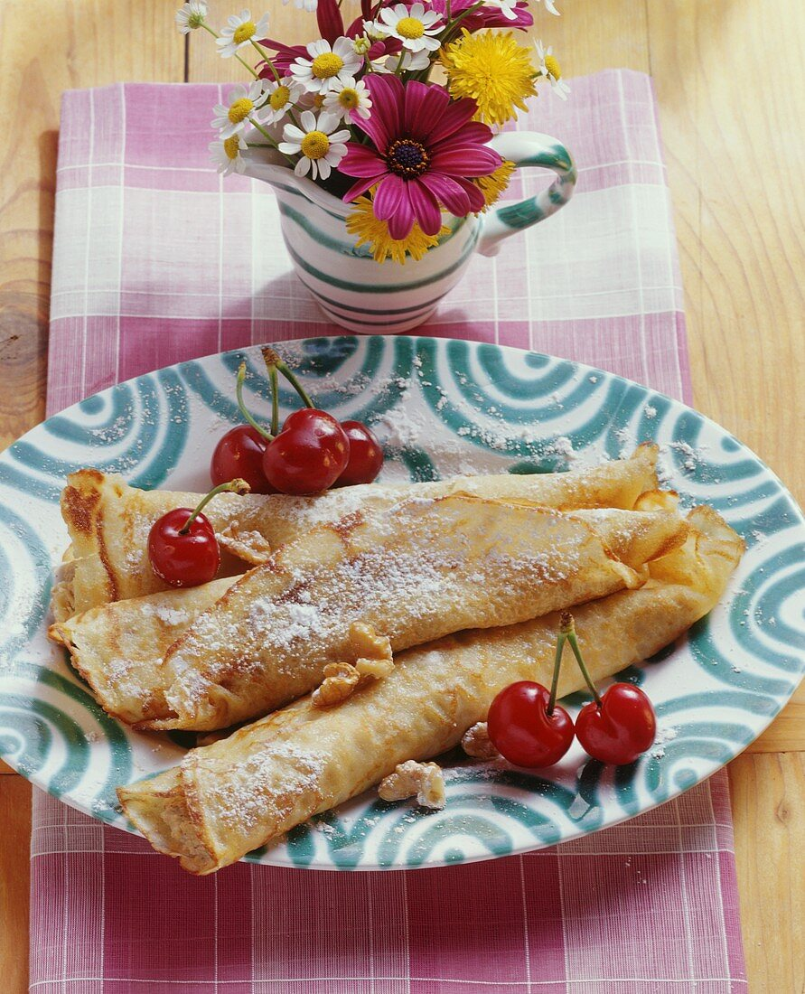 Filled pancakes (Palatschinken) with nuts and cherries
