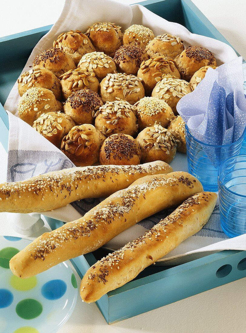 Bread roll sun and bread sticks with salt and caraway