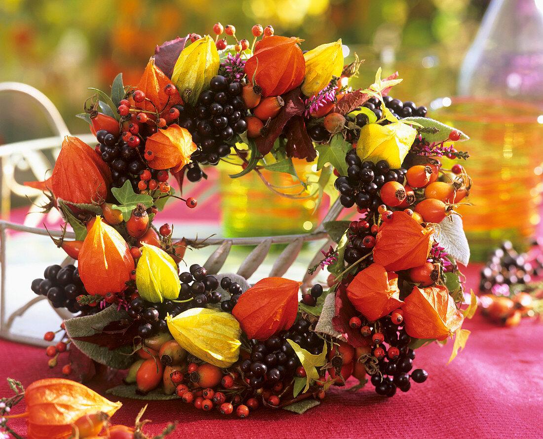 Wreath of privet berries, rose hips and Physalis