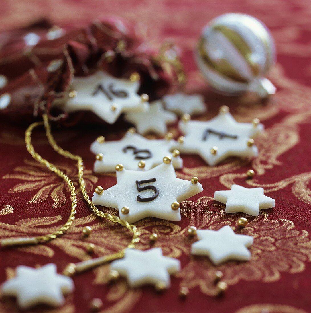 White fondant stars for an Advent calendar