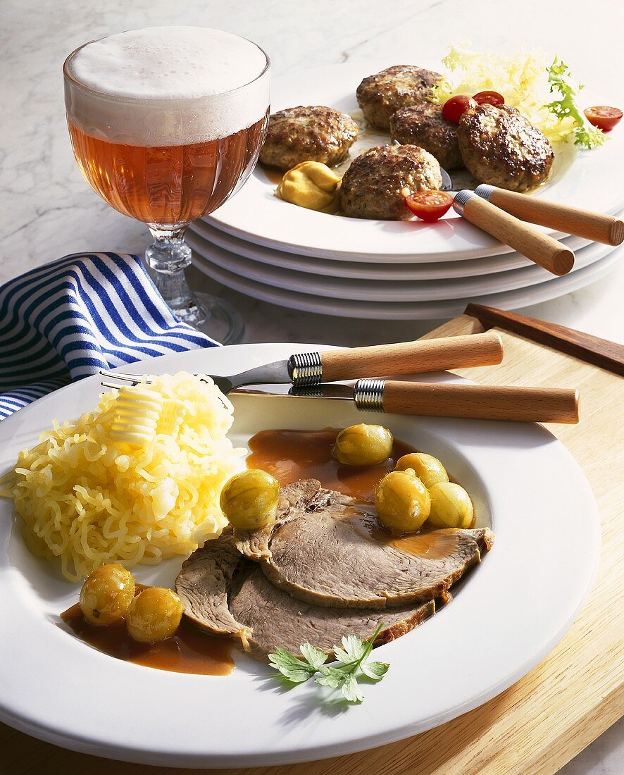 Roast veal with gooseberry sauce, burgers and beer