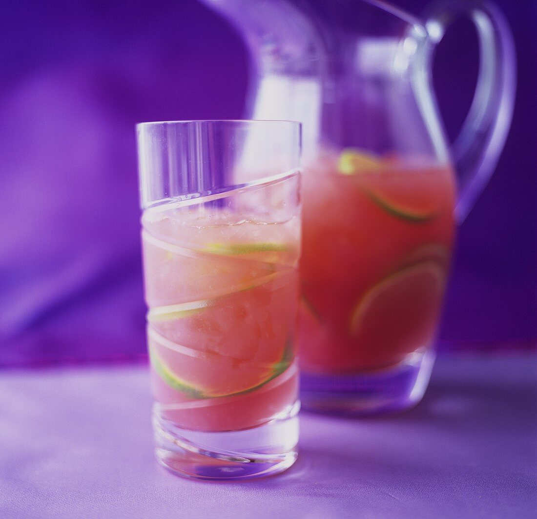 Watermelon drink with slices of lime