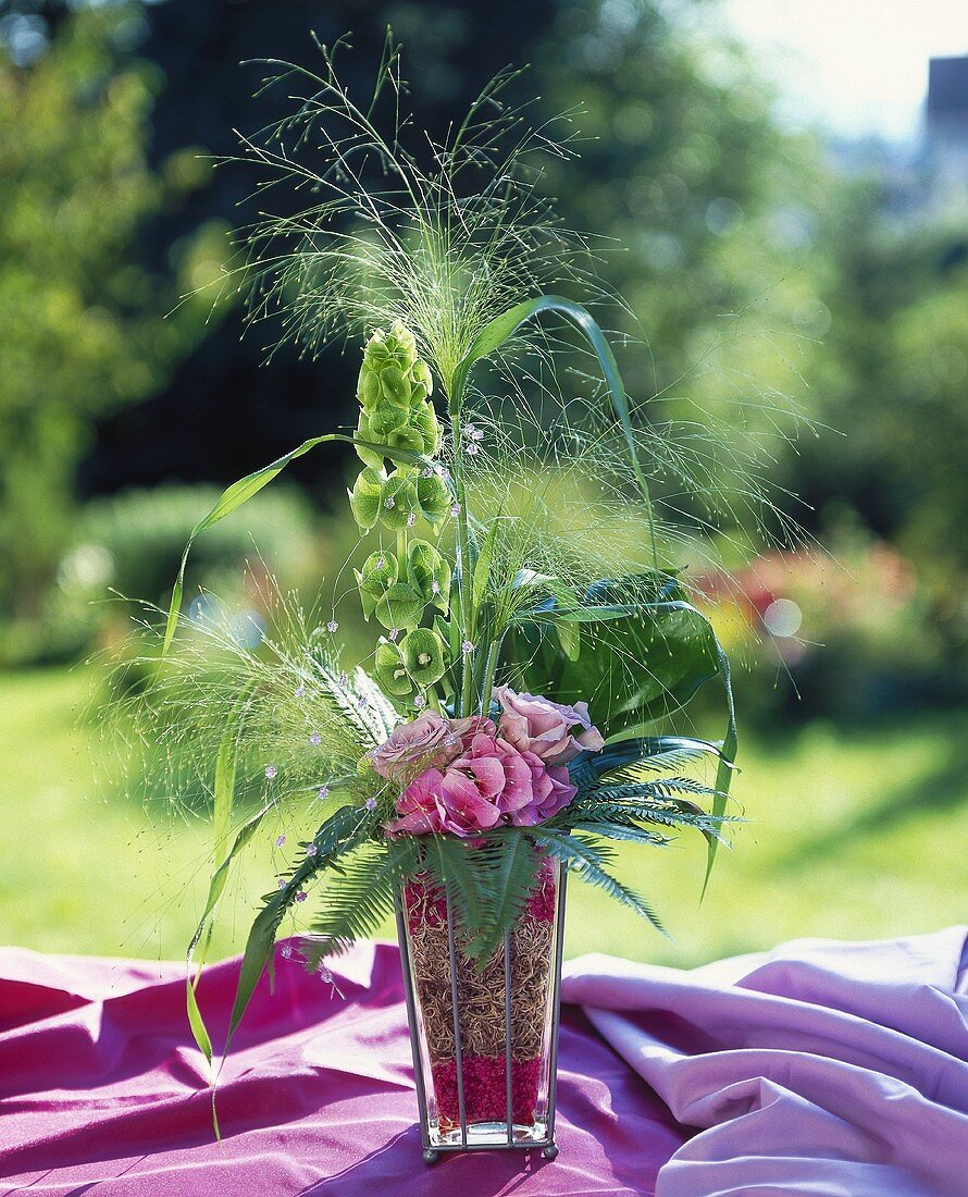 Delicate grasses with hydrangea, coral fern & bells of Ireland