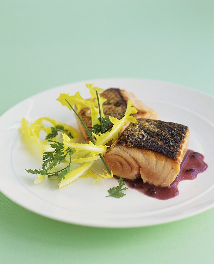 Fried salmon in red wine sauce with dandelion leaves