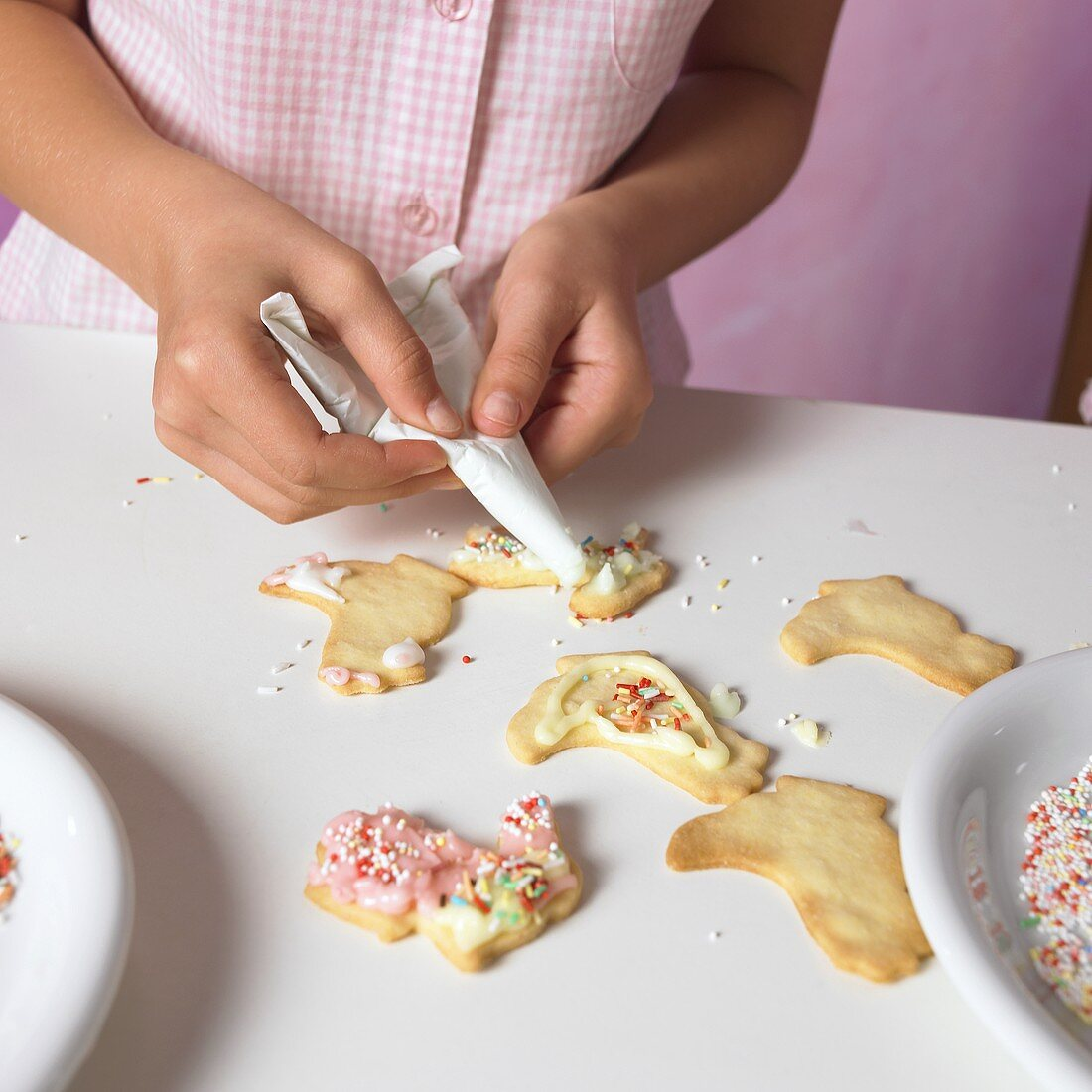Girl decorating Easter biscuits