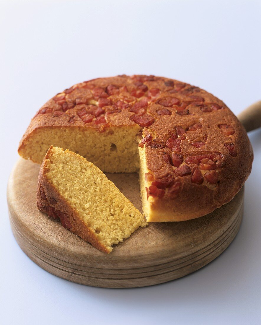 Polenta cake with pancetta, a piece cut (Aga Cooking)