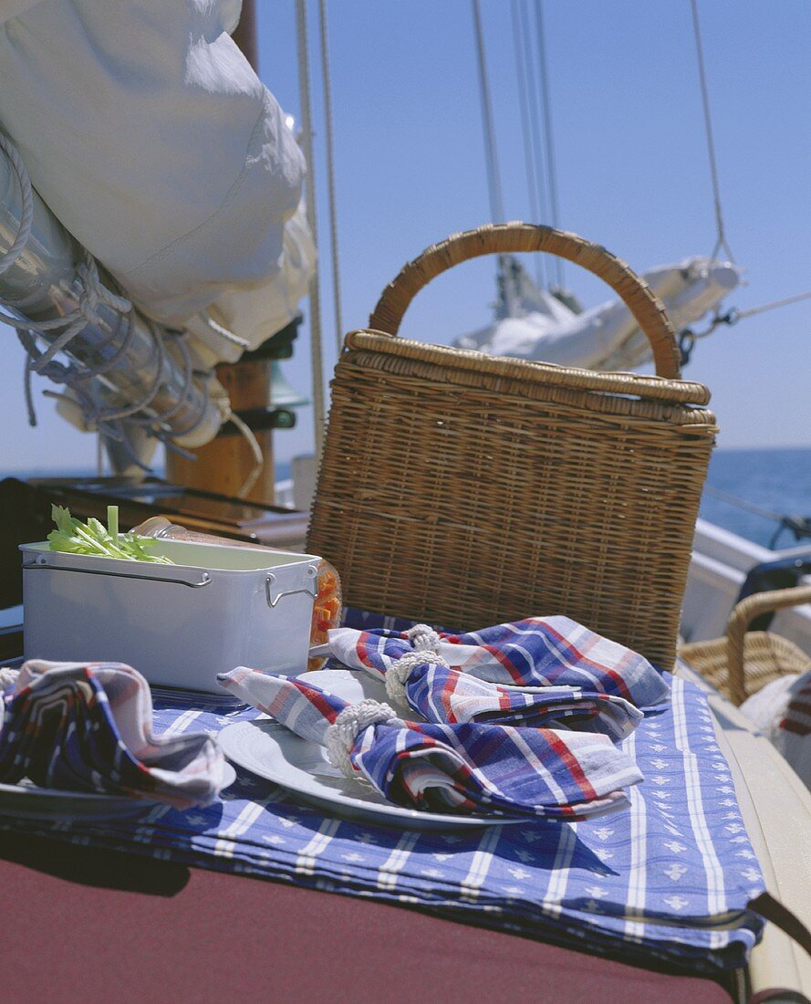 Picnic basket and picnic things on yacht at seaside