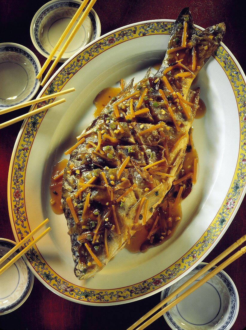 Sweet and sour carp with carrot strips